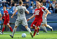 HOOVER, AL - DECEMBER 09, 2012: Caleb Konstanski (22) of Indiana University sends the ball past Steve Neumann (18) of Georgetown University during the NCAA 2012 Men's College Cup championship, at Regions Park, in Hoover , AL, on Sunday, December 09, 2012.