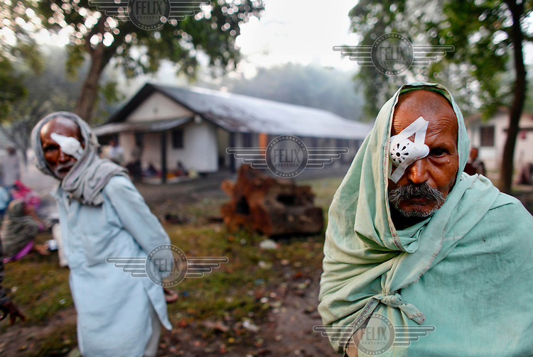 61 year old Malti Prashad and 62 year old Puttu Lal await the removal of their bandages after having an operation at the GETA eye hospital. The hospital is too crowded to accommodate them.