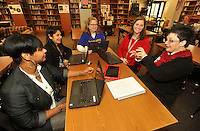 NWA Media/Michael Woods --12/18/2014-- w @NWAMICHAELW...Julie Cobb, a technology integration specialist at Ramsey Middle School in Fort Smith, (right) meets with Ramsey Middle School teachers (left to right) Marcia Hood, Maria Galvan, Cindy Dean and Mary Sutton Thursday morning in the school library to talk about planning for the next semester.