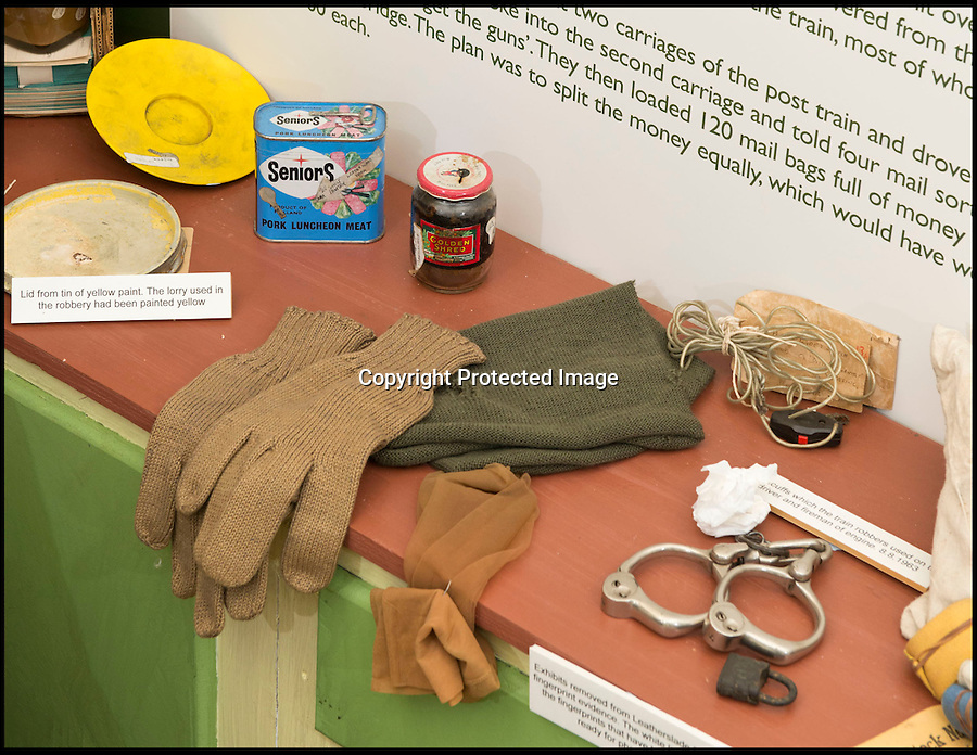 BNPS.co.uk (01202 558833)<br /> Pic: RachelAdams/BNPS<br /> <br /> Artefacts recovered from the raid including a tin of spam and a set of handcuffs. <br /> <br /> A Monopoly set famously played by the Great Train Robbers using real money while lying low at a farm after there £2.6 million heist has emerged 50 years after the infamous event.<br /> <br /> The tatty board game came to light after it was brought to the Antiques Roadshow for valuation, revealing the little-known story of its part in the 20th century's most notorious heist.<br /> <br /> It was discovered by police in a farmhouse hideout days after the brazen hold-up on a Royal Mail train in 1963.<br /> <br /> The train had been travelling from Glasgow to London but was set upon at Ledburn in Buckinghamshire by the gang, who had tampered with signals.<br /> <br /> The robbers stormed the train and took all but seven of 128 highly-prized sacks worth a total of £2.6 million - the equivalent of nearly £50 million nowadays.<br /> <br /> Following the robbery the gang, including ringleader Bruce Reynolds, Buster Edwards and Ronnie Biggs - retreated to a nearby farmhouse to avoid police.<br /> <br /> There they played the board game to pass the time and would use real money to buy 'property'.