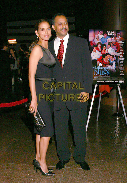 HALLE BERRY & RUBEN SANTIAGO-HUDSON.Lackawanna Blues - HBO Screening held at The Directors Guild of America. West Holllywood, California..Photo Credit: Zach Lipp/AdMedia.February 3rd, 2005.full length black sleeveless dress silk satin ribbon black clutch purse black suit.www.capitalpictures.com.sales@capitalpictures.com.© Capital Pictures.