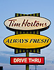 A sign for a Tim Hortons franchise location in the town of Cheticamp, Nova Scotia.  Horton, who played hockey for the Toronto Maple Leafs, hailed from Nova Scotia - which accounts for the popularity of the chain.  On Nova Scotia, there are only two Starbucks shops, but 59 towns or villages are home to a Tim Hortons.  Photo by Kevin J. Miyazaki/Redux