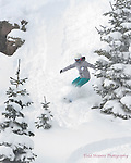 Snowboarder Emma Shapera ripping up deep December powder at Wolf Creek, Colorado