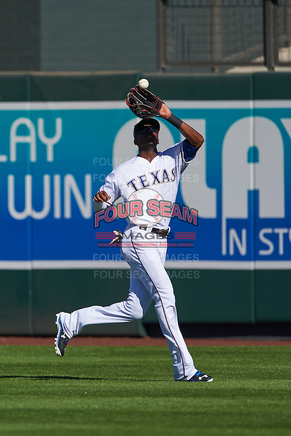 Surprise Saguaros outfielder Lewis Brinson (5) catches a fly ball during an Arizona Fall League game against the Glendale Desert Dogs on October 23, 2015 at Salt River Fields at Talking Stick in Scottsdale, Arizona.  Glendale defeated Surprise 9-6.  (Mike Janes/Four Seam Images)