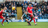 Luke O'Nien of Wycombe Wanderers battles with Nigel Atangana of Leyton Orient during the Sky Bet League 2 match between Wycombe Wanderers and Leyton Orient at Adams Park, High Wycombe, England on 23 January 2016. Photo by Andy Rowland / PRiME Media Images.
