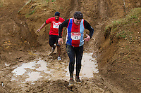 06 FEB 2011 - SIBBERTOFT, GBR - Richard Sloan picks his way through the mud as he makes his way through the quarry at the Avalanche Adventure Run (PHOTO (C) NIGEL FARROW)