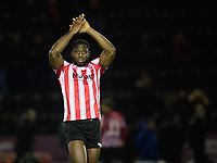 Lincoln City's John Akinde applauds the fans at the final whistle<br /> <br /> Photographer Chris Vaughan/CameraSport<br /> <br /> The EFL Checkatrade Trophy Northern Group H - Lincoln City v Wolverhampton Wanderers U21 - Tuesday 6th November 2018 - Sincil Bank - Lincoln<br />  <br /> World Copyright © 2018 CameraSport. All rights reserved. 43 Linden Ave. Countesthorpe. Leicester. England. LE8 5PG - Tel: +44 (0) 116 277 4147 - admin@camerasport.com - www.camerasport.com