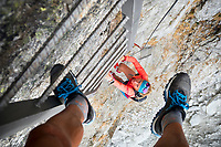 Looking through the legs while climbing a ladder at the person below. Salbit, Switzerland.