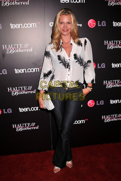 """NATASHA HENSTRIDGE.Teen.com's """"Haute & Bothered"""" Online Series Launch Party held at the Sunset Tower Hotel, West Hollywood, CA, USA..May 4th, 2009.full length white black sheer blouse top clutch bag grey gray feather print jeans denim hand in pocket .CAP/ADM/BP.©Byron Purvis/AdMedia/Capital Pictures."""