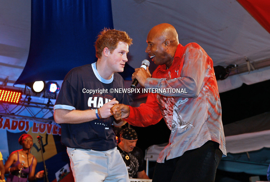 """PRINCE HARRY_Takes to the stage to dance to the local groups.He was attending a concert at Farley Hill, Barbados in aid of the Haiti Earthquake wearing a 'Haiti We Care T-shirt Barbados. Prince Harry is on a 3-day  Royal Tour of Barbados_30/01/2010.Mandatory Credit Photo: ©DIAS-NEWSPIX INTERNATIONAL..**ALL FEES PAYABLE TO: """"NEWSPIX INTERNATIONAL""""**..IMMEDIATE CONFIRMATION OF USAGE REQUIRED:.Newspix International, 31 Chinnery Hill, Bishop's Stortford, ENGLAND CM23 3PS.Tel:+441279 324672  ; Fax: +441279656877.Mobile:  07775681153.e-mail: info@newspixinternational.co.uk"""