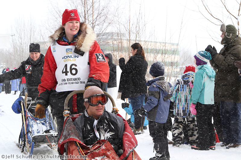 Ryne Olson Mushes through Bike/ski trail in midtown Anchorage, During the 2012 Iditarod ceremonial start..Britt Coon/Iditarodphotos.com.