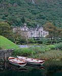 County Galway, Ireland<br /> Fishing boats moored on Kylemore Lough with Kylemore Abbey on the far shore