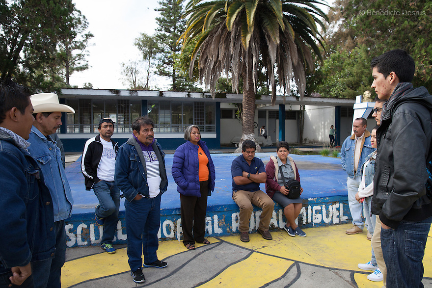 """Felipe de la Cruz Sandoval (C), the spokesman for theparents, and parents of the 43 missing students from Ayotzinapa's teacher training college meet with students from Tvla at """"Miguel Hidalgo"""" teacher-trainingcollege in Atequiza, Jalisco, Mexico on November 18, 2014. The parents and relatives of the 43 missing students still do not believe the official line that the young men are all dead, and with classmates, social organizations and human rights defenders, they started on Thursday a national caravan. They split up into three different caravans, branching out to share information face to face with supporters in other cities and rally nationwide support. The three groups will meet in Mexico City on Thursday 20 for a general strike and massive marches to demand justice and fight against corrupted government and organized crime. Criticism of the government has intensified in Mexico, and many are demanding that the search for the 43 missing students continue until there is concrete evidence to the contrary. (Photo by BénédicteDesrus)"""