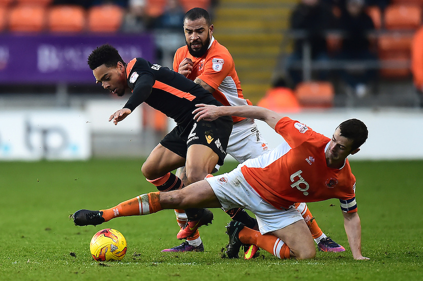 Blackpool's Danny Pugh (R) and Kyle Vassell challenge Newport County's Jazzi Barnum-Bobb<br /> <br /> Photographer Richard Martin-Roberts/CameraSport<br /> <br /> The EFL Sky Bet League Two - Blackpool v Newport County - Saturday 26th November 2016 - Bloomfield Road - Blackpool<br /> <br /> World Copyright &copy; 2016 CameraSport. All rights reserved. 43 Linden Ave. Countesthorpe. Leicester. England. LE8 5PG - Tel: +44 (0) 116 277 4147 - admin@camerasport.com - www.camerasport.com