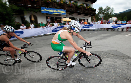 23 JUN 2012 - KITZBUEHEL, AUT - Aileen Morrison (IRL) of Ireland (right, in green and white) leads a chase pack during the bike at the elite women's 2012 World Triathlon Series round in Schwarzsee, Kitzbuehel, Austria (PHOTO (C) 2012 NIGEL FARROW)