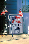 vote here sign with American flags