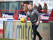 17th March 2019, Dens Park, Dundee, Scotland; Ladbrokes Premiership football, Dundee versus Celtic; Celtic Caretaker Manager Neil Lennon retrieves the ball to get the game re-started