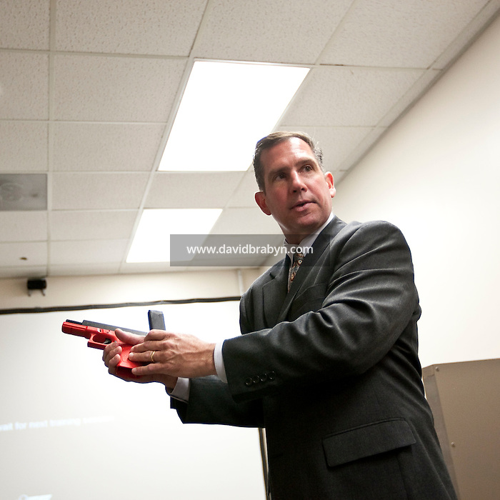 Supervisory Special Agent Richard Schott demonstrates the use of a gun during a session on the Fire Arms Training Simulator (or FATS) at the FBI National Academy in Quantico, VA, USA, 12 May 2009.