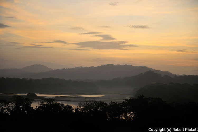 Sunrise View over Jungle Canopy & Gatun Lake, Panama, Central America, Gamboa Reserve, Parque Nacional Soberania, sunbeams through clouds
