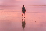 NEW ZEALAND, Northland, Woman on Ninety Mile Beach at Sunset, Ben M Thomas