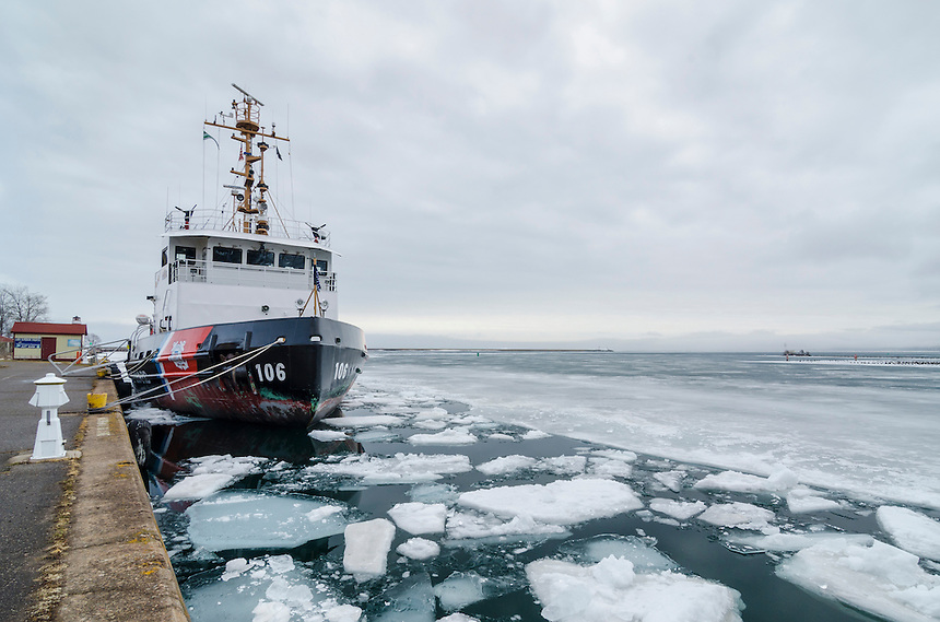 The U.S. Coast Guard's Morro Bay sits in Marquette's lower harbor after escorting two freighters through the frozen waters of Lake Superior. Marquette, MI