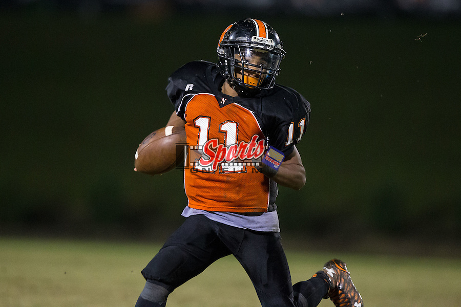 IJ Sturdiant (11) of the Northwest Cabarrus Trojans runs with the football during second half action against the Concord Spiders at Trojan Stadium October 29, 2015, in Concord, North Carolina.  The Spiders defeated the Trojans 30-26.  (Brian Westerholt/Sports On Film)