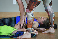 "NWA Democrat-Gazette/CHARLIE KAIJO Instructor Kari Pace (top) helps Blaine Wooldridge, 6, of Bella Vista (bottom) with a cool down exercise during a kids yoga class, Monday, July 8, 2019 at Yoga Story in Bentonville. <br /> <br /> ""It helps them to learn to breath, pay attention to their bodies, work through emotions and sensations,"" said instructor Kari Pace describing the benefits of yoga for kids. ""I was a very anxious kid so it would have been nice to have a technique like this. It's fun to share it with my kids and other kids."""