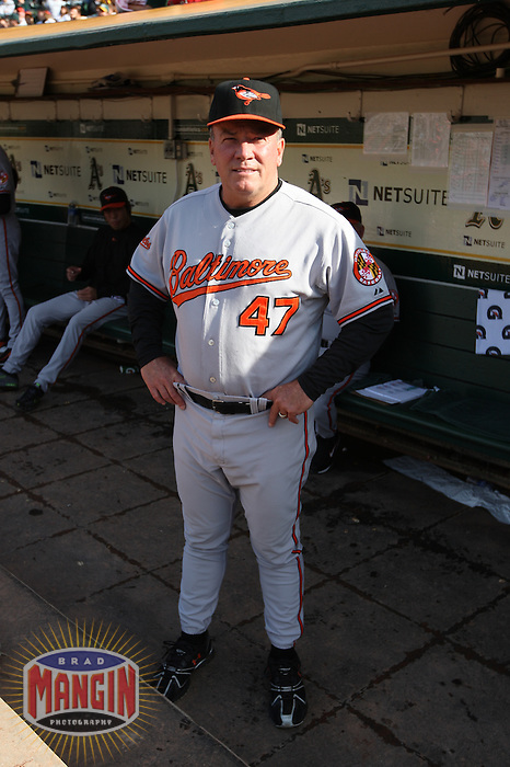 OAKLAND, CA - JUNE 6:  Manager Dave Trembley #47 of the Baltimore Orioles gets ready in the dugout before the game against the Oakland Athletics at the Oakland-Alameda County Coliseum on June 6, 2009 in Oakland, California. Photo by Brad Mangin