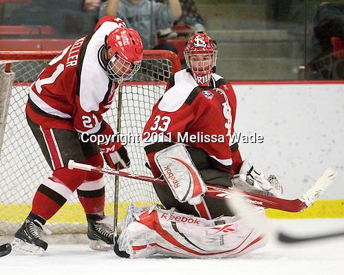 Jared Keller (St. Lawrence - 21), David Grilk (St. Lawrence - 33) - The Harvard University Crimson defeated the St. Lawrence University Saints 4-3 on senior night Saturday, February 26, 2011, at Bright Hockey Center in Cambridge, Massachusetts.