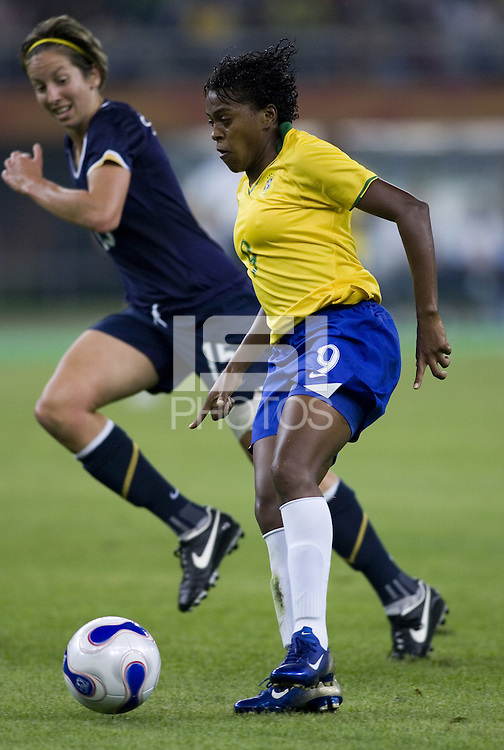Brazil midfielder (9) Maycon and Australia midfielder (15) Sally Shipard. Brazil defeated Australia, 3-2 during the quarterfinals of the FIFA Women's World Cup at Tianjin Olympic Center Stadium in Tianjin, China on September 23, 2007.
