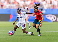 REIMS,  - JUNE 24: Crystal Dunn #19 moves past Vicky Losada #6 during a game between NT v Spain and  at Stade Auguste Delaune on June 24, 2019 in Reims, France.