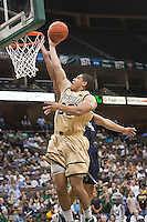 February 24, 2012:   Jacksonville Dolphins guard Tevin Galvin (23) goes up for a basket during Atlantic Sun Conference action between the Jacksonville Dolphins and the North Florida Ospreys at Veterans Memorial Arena in Jacksonville, Florida. North Florida defeated Jacksonville 70-64.