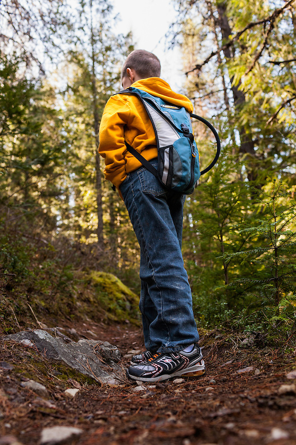A young boy hikes along a trail near Priest River, Idaho in Bonner County.