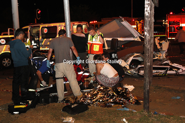 DURBAN - 5 September 2013 - Paramedics attend to one of the many who were injured in a crash that claimed the lives of 24 people, who were killed when a lorry's brakes failed on Field's Hill in Pinetown and ploughed through four taxis and a car. Picture: Allied Picture Press/APP