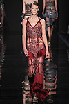 "Model walks runway in a bordeaux silk fringe dress with lace underpinning from the Reem Acra Fall 2016 ""The Secret World of The Femme Fatale"" collection, at NYFW: The Shows Fall 2016, during New York Fashion Week Fall 2016."