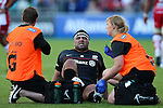Saracens' Kieran Longbottom in pain while being treated during his first home game since joining Saracens in the summer - Rugby Union - 2014 / 2015 Aviva Premiership - Saracens vs. Gloucester - Allianz Park Stadium - London - 11/10/2014 - Pic Charlie Forgham-Bailey/Sportimage