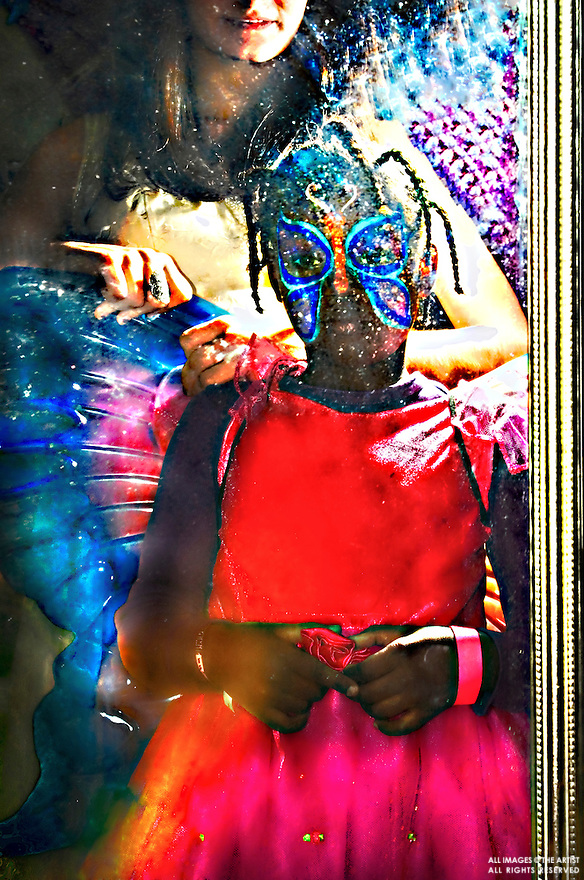 Laura Bergerol, Mirror image of a child getting her Halloween costume!