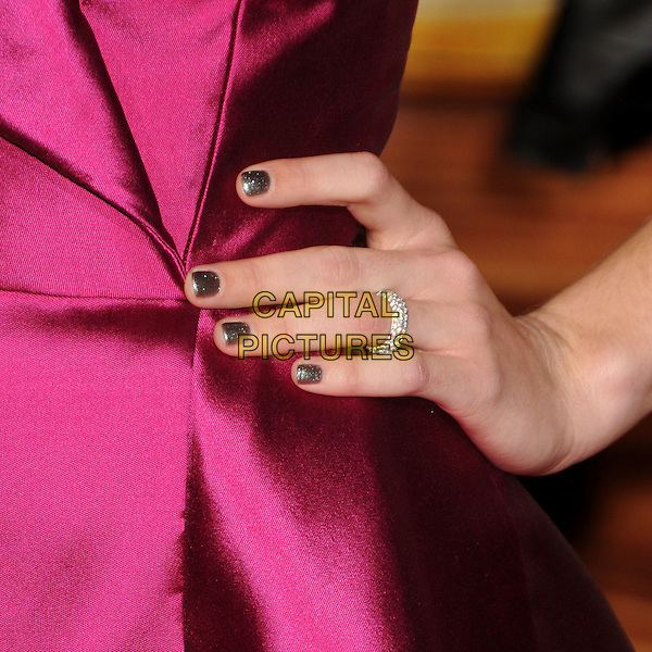 "MANDY MOORE's ring.""Tangled"" Los Angeles Premiere held at the El Capitan Theatre, Hollywood, California, USA..November 14th, 2010.hand on hip nail varnish polish gold glitter pink silk satin  .CAP/ADM/BP.©Byron Purvis/AdMedia/Capital Pictures."