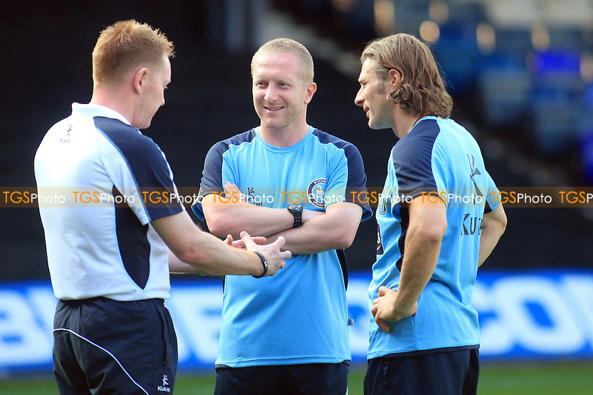 Wycombe Manager, Gary Waddock has a word with his Assistant Richard  Dobson and Player/Coach Gareth Ainsworth - Luton Town vs Wycombe Wanderers - Friendly Football Match at Kenilworth Road, Luton, Befordshire - 25/07/12 - MANDATORY CREDIT: Paul Dennis/TGSPHOTO - Self billing applies where appropriate - 0845 094 6026 - contact@tgsphoto.co.uk - NO UNPAID USE.