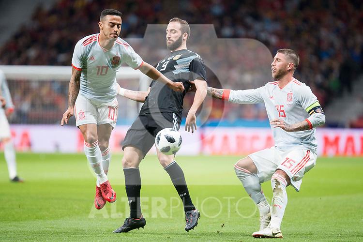 Spain Thiago Alcantara and Sergio Ramos and Argentina Gonzalo Higuaín during friendly match between Spain and Argentina at Wanda Metropolitano in Madrid , Spain. March 27, 2018. (ALTERPHOTOS/Borja B.Hojas)