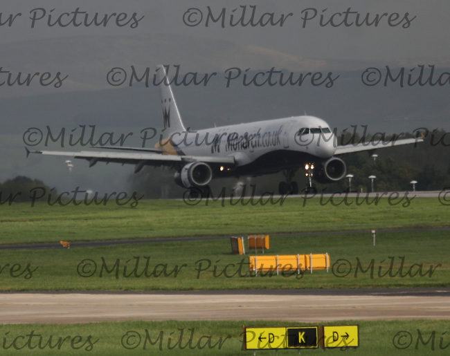 A Monarch Airlines Airbus A321-231Registration G-OZBM from Malaga Airport landing at Manchester Airport on 17.10.13.