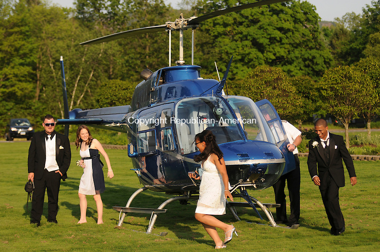 SOUTHINGTON, CT-21 MAY 2010-052110IP01- (l to r) Kennedy High School students Jon Greco, Melissa DeCosmo, Mercedes Caban and Roberto Quinones leave the helicopter they flew in to their senior prom after it landed on the grounds of the Aqua Turf Club in Southington on Friday. The helicopter was piloted by Andrew Hayden of AirOcean Aviation, LLC.                                                                                                                                                                                                                                                                                                                                                                                                                                                                                                                                                                                                                                                                                                                                                                                                                                                                                                                                                                                                                                                                                                                                                                                                                                                                                                                                                                                                                                                                                                                    <br /> Irena Pastorello Republican-American