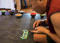 NWA Democrat-Gazette/CHARLIE KAIJO Monk Yeshi Topgyal of Minnesota, Minn creates a sand sculpture during the Creation of the Healing Sand Mandala ceremony, Sunday, November 4, 2018 at the Basin Park Hotel in Eureka Springs.<br />