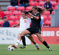Katie Stengel (12) of Wake Forest fights for the ball with Erika Nelson (15) of Maryland during the game at Ludwig Field in College Park, MD.  Maryland defeated Wake Forest, 1-0.