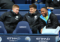 26th January 2020; Etihad Stadium, Manchester, Lancashire, England; English FA Cup Football, Manchester City versus Fulham; Kevin De Bruyne of Manchester City chats with fellow Manchester City substitutes John Stones and Raheem Sterling