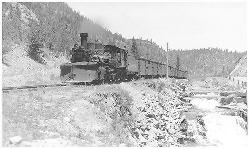 Full train length view - fireman side - of K-27 #464 southbound with a string of thirteen box cars as seen from Leopard Creek.<br /> RGS  Leopard Creek, CO  Taken by Perry, Otto C. - 6/26/1945
