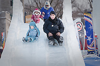 Dominick Miserandino looks petrified as he ride an ice slide with his daughter Caterina at the Quebec Winter Carnival (Carnaval de Quebec) in Quebec city, February 3, 2010. With close to one million participants, it has grown to become the third largest winter celebration in the world.