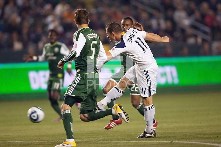 Chad Barrett (11) forward for the LA Galaxy with his scoring shot on goal. The LA Galaxy defeated the Portland Timbers 3-0 at Home Depot Center stadium in Carson, California on  April  23, 2011....