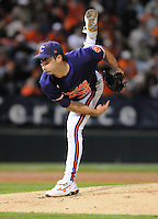 Starting pitcher David Haselden (29) of the Clemson Tigers throws in the first inning of a game against the South Carolina Gamecocks on Tuesday, March 8, 2011, at Fluor Field in Greenville, S.C.  Photo by Tom Priddy / Four Seam Images