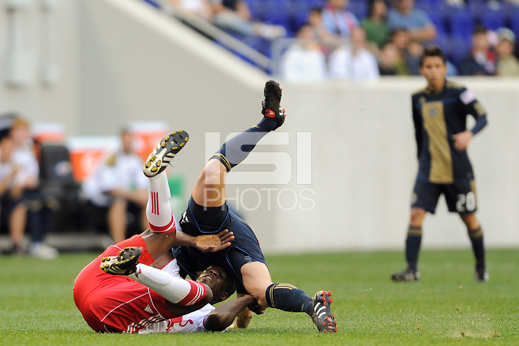Cristian Arrieta (26) of the Philadelphia Union falls over Ibrahim Salou (29) of the New York Red Bulls while going for a header. The New York Red Bulls defeated the Philadelphia Union 2-1 during a Major League Soccer (MLS) match at Red Bull Arena in Harrison, NJ, on April 24, 2010.